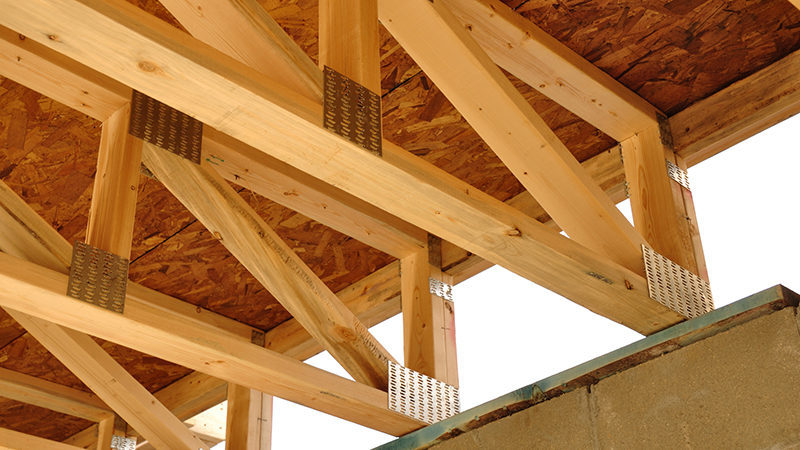 Trusses Above Basement of House at Construction Site as seen during home inspection services