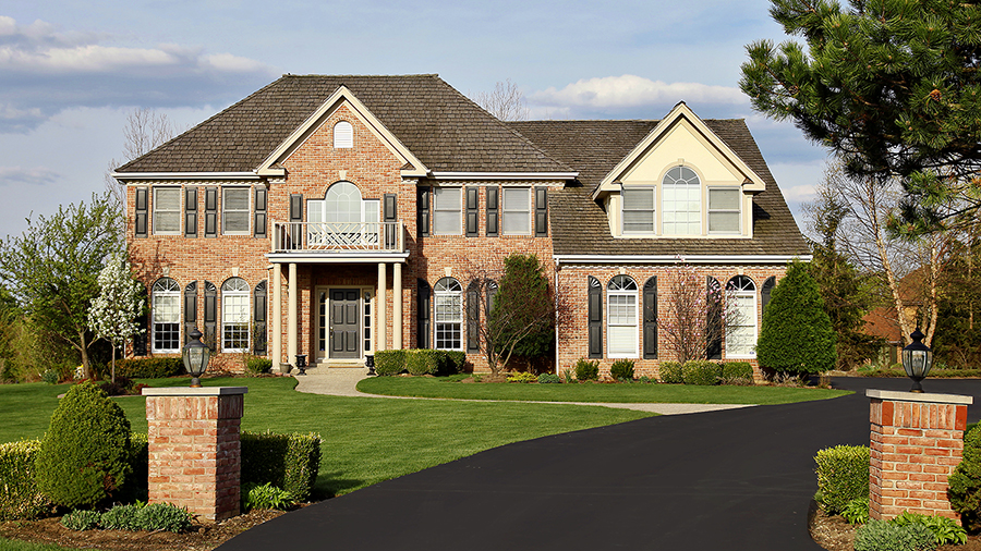 Exterior of a luxury brick home during a home inspection